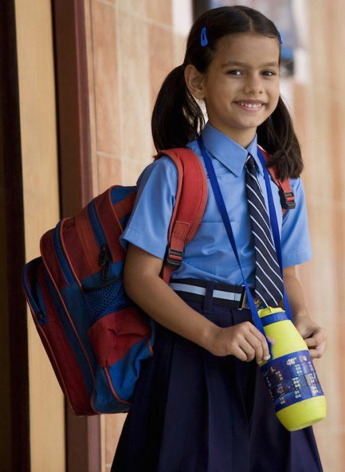 Female child in school uniform